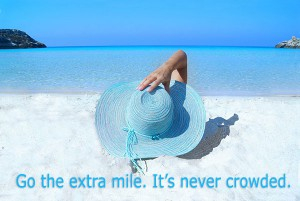 Go the extra mile. It's ever crowded. Girl with blue floppy hat on the beach